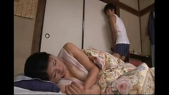 Beautiful Japanese mom gets spooned by her horny guy