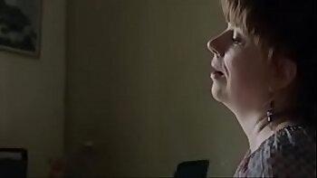 Brown birtaged mature woman wanks a throbbing boner in erotic video