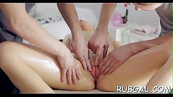 Babe massages her bushy cunt on sunbed